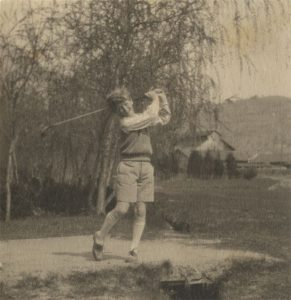 Playing golf, late 1920s